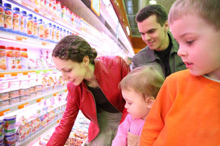family in food shop photo