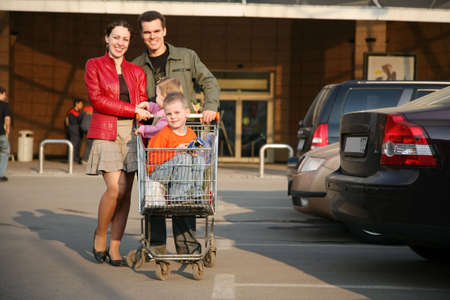 shopping carriage: family on shop parking