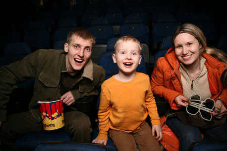 family in cinema photo