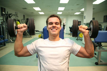 circular muscle: gym man with dumbbells  Stock Photo