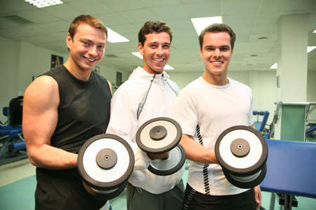 circular muscle: three gym men with dumbbells