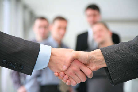 human finger: shaking hands and business team