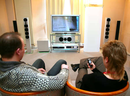 entertainment center: couple with home theater