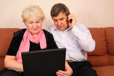 senior couple with notebook photo