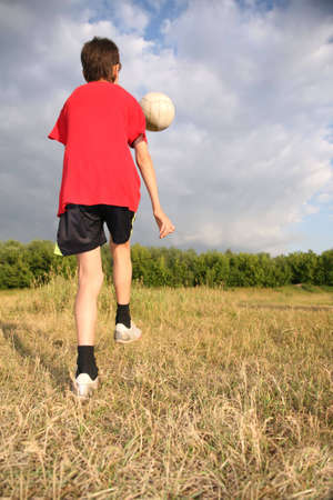 boy with ball on meadow Stock Photo - 2274908