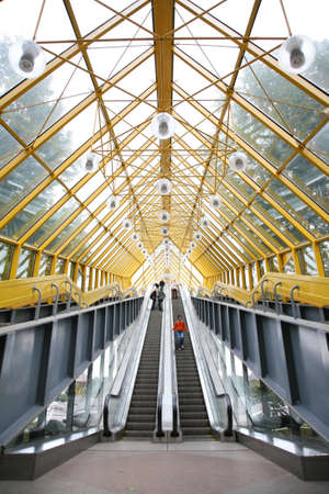 diagonals: people on footbridge Stock Photo