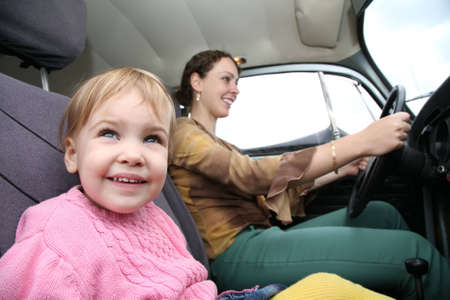 child with mother in car photo