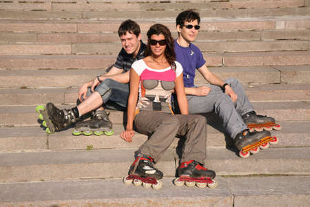 rollerblades: three rollers sit on the stairs