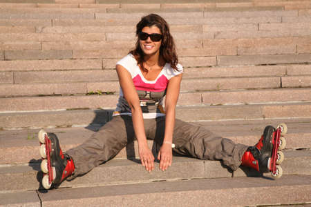 roller skate: girl-roller sits on the stairs 2