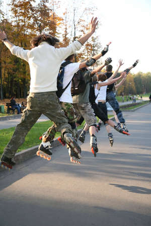 rollerblades: group of rollers jump