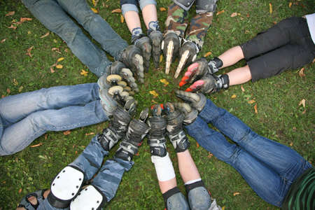 seven persons: group circle roller skates Stock Photo