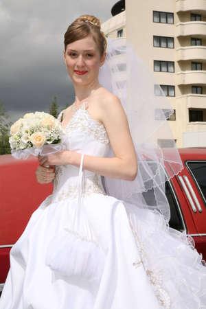 Bride aside of automobile photo