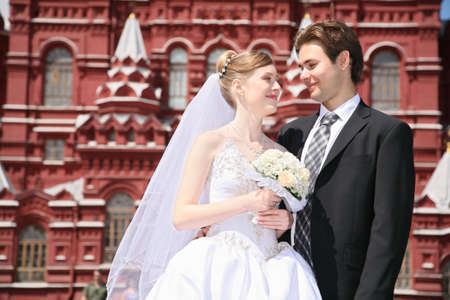 fiance and bride against the background of historical museum in Moscow photo