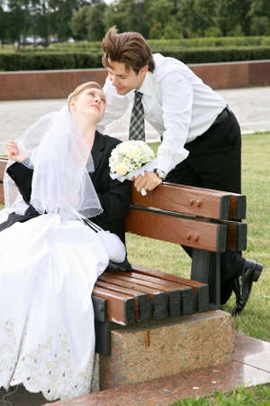 bride sits on the bench and looks at the fiance Stock Photo - 2281731