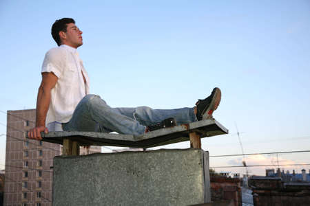 man sits on the roof photo