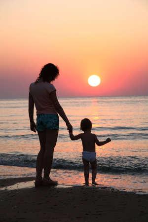 Mummy with  on sunset at sea Stock Photo - 2275059