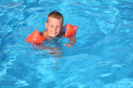 The boy floats in pool Stock Photo - 2286410