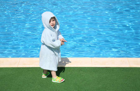 banian: The child in a dressing gown about pool