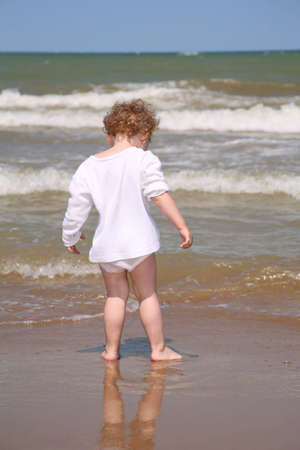 The child goes to the sea. photo