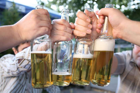 four hands with the bottles of the beer Stock Photo - 2281378