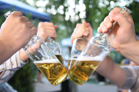 four hands with the bottles of the beer 2 Stock Photo - 2281355