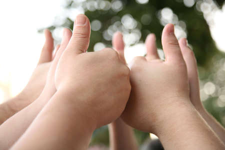 unanimous: hand with the raised thumbs Stock Photo