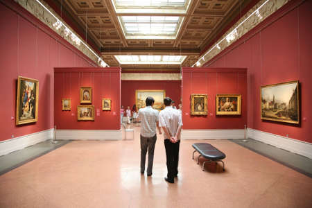 exhibitions: visitors in the museum Stock Photo