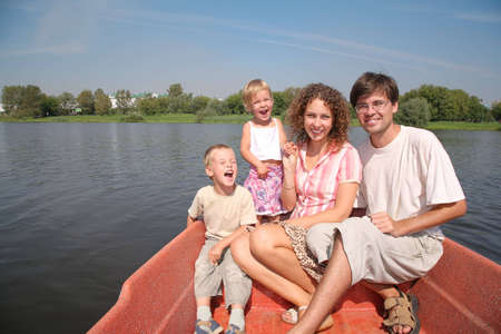 lake front: family with the children in the boat