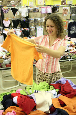 woman with shirt in shop Stock Photo - 2286335