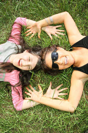 mother and daughter lie on the grass 2 photo