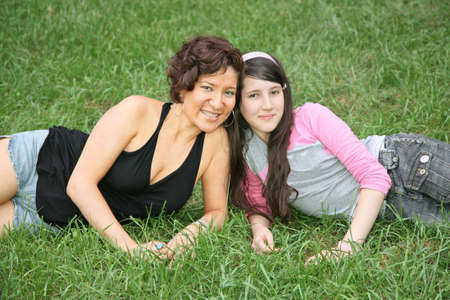 mother and daughter-teenager lie on the grass 3 photo