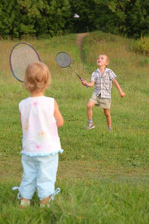 boy and girl play badminton photo