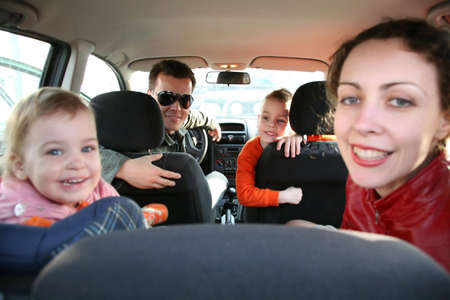 back seat: family in car Stock Photo