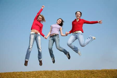 helpmate: three jumping girls Stock Photo