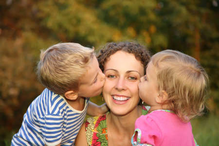 loveable: children kiss the mother