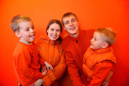 Family together on an orange background Stock Photo - 2290321