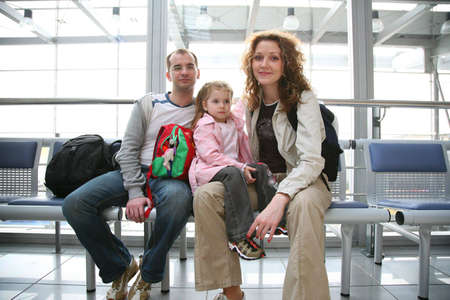 mother on bench: traveling family
