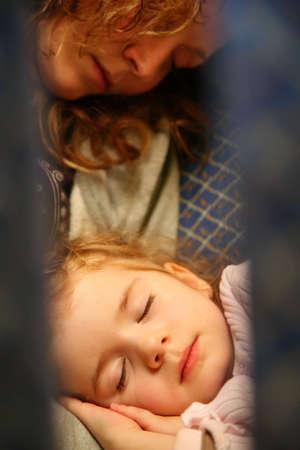 mother child airplane sleep photo