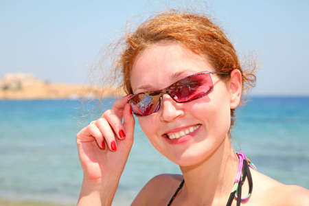 The woman on the sea in solar glasses Stock Photo - 2297210
