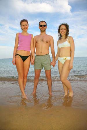 The man and girls on the sea photo