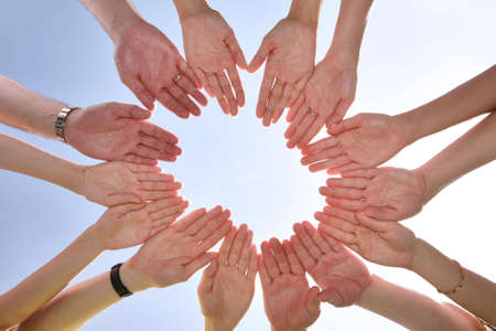 teaming: The group has connected hands