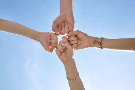 peace plan: four fists on sky