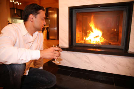 man and fireplace, focus on glass Stock Photo - 2297179