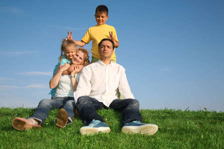 family sitting grass Stock Photo - 2308467