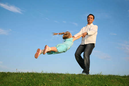 rotate: father rotate daughter Stock Photo