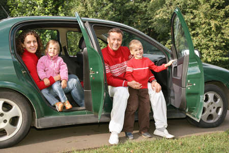 family sitting in car