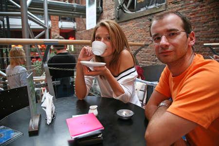 man woman cafe photo