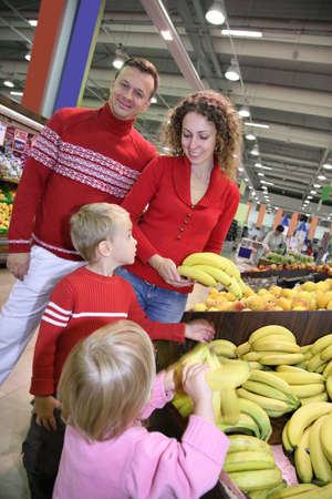 parents with child in shop photo