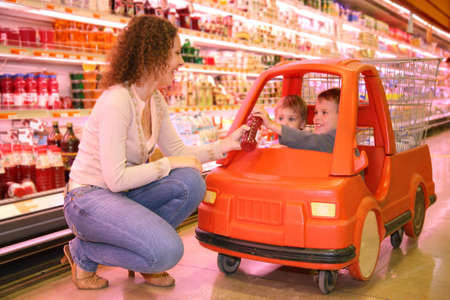mother with the children in the store Stock Photo