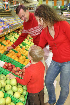health food store: parents with son in shop